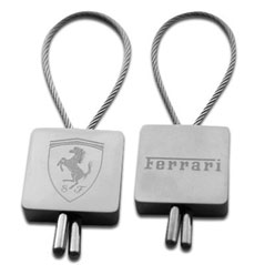 Description: http://www.schumacher-fanclub.com/media/sfx8921-ferrari-metal-wire-etched-logo-keychain-02.jpg